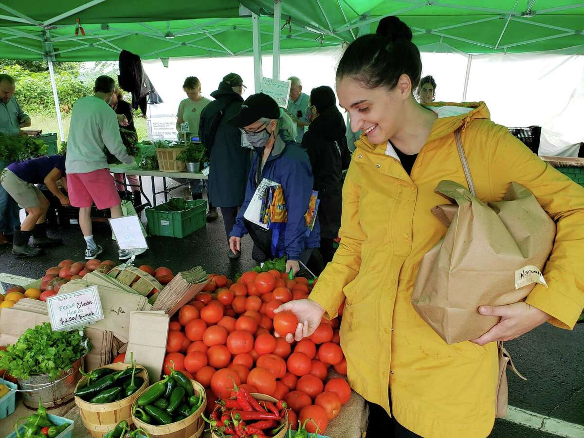 Caitlin McGowan, chef at The Art Space Cafe in Norwalk, shopping at the Westport Farmers market.