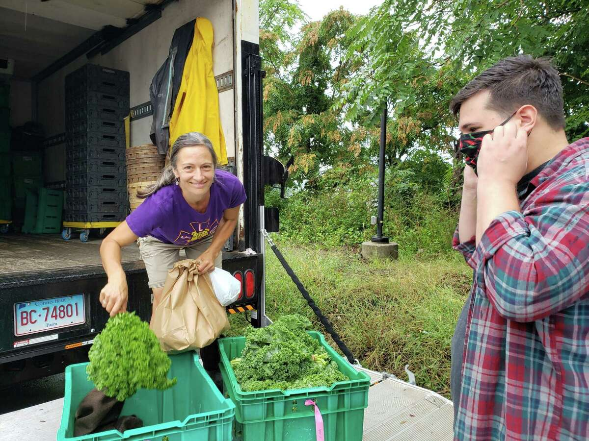 Chef Alec Demonico of Kawa Ni in Westport picking up produce from Rebecca Batchie of Fort Hill Farm.