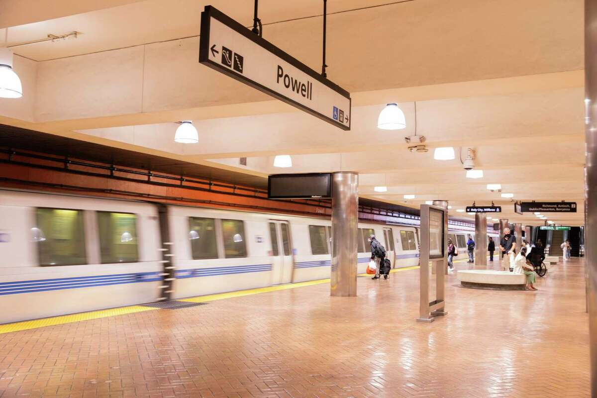 San Francisco commuters load onto a BART train at the Powell Station in San Francisco , Calif.