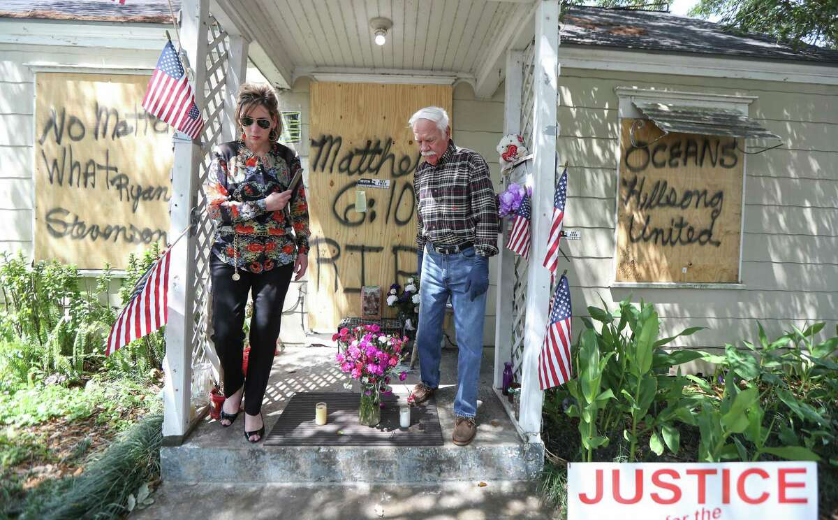 Shawna Fugate (left) aids Cliff Tuttle, uncle of shooting victim Dennis Tuttle, as they prepare to enter 7815 Harding for the first time since the raid Tuesday, April 16, 2019, in Houston.