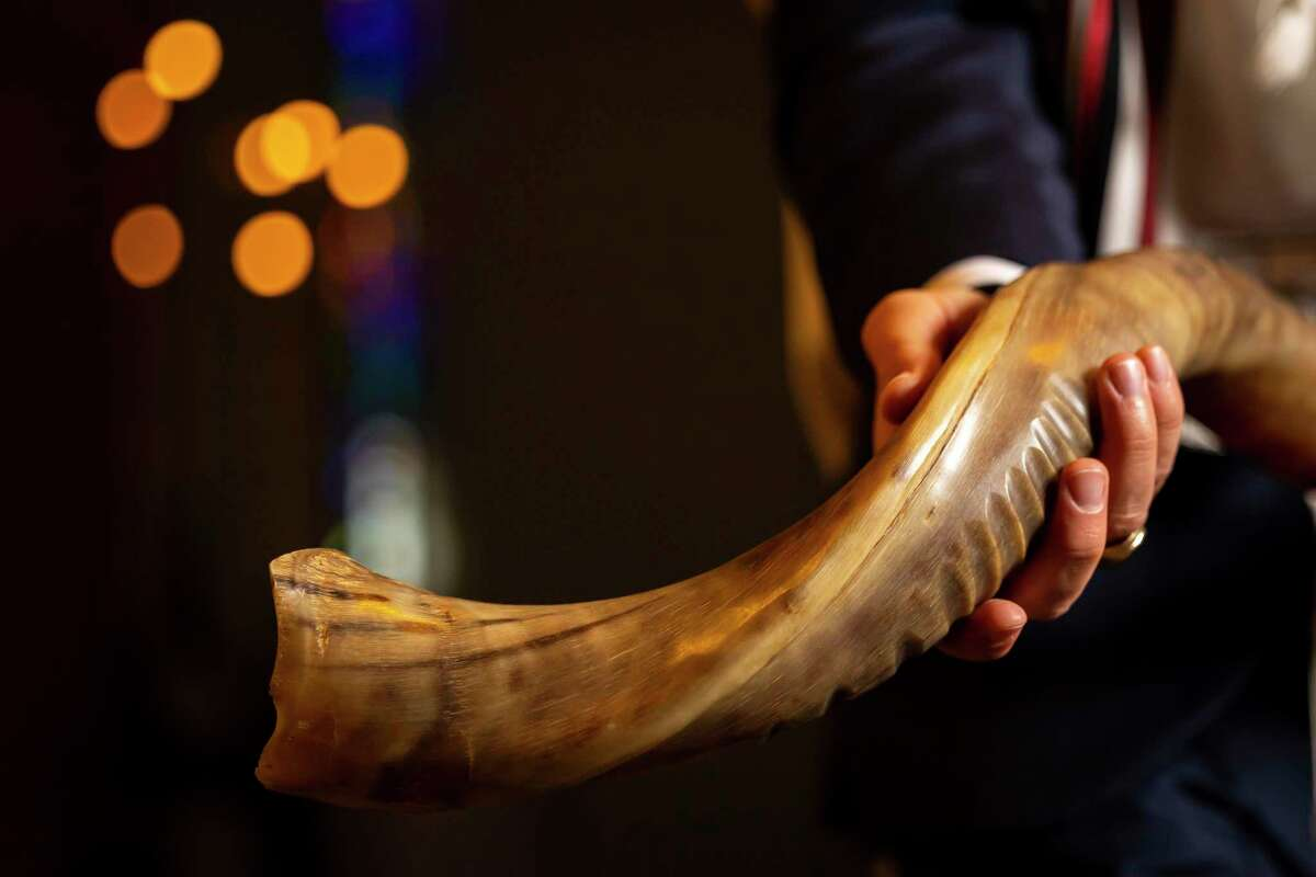 The shofar is a ram's horn that functions as a trumpet and calls Jewish people to worship for the new year.