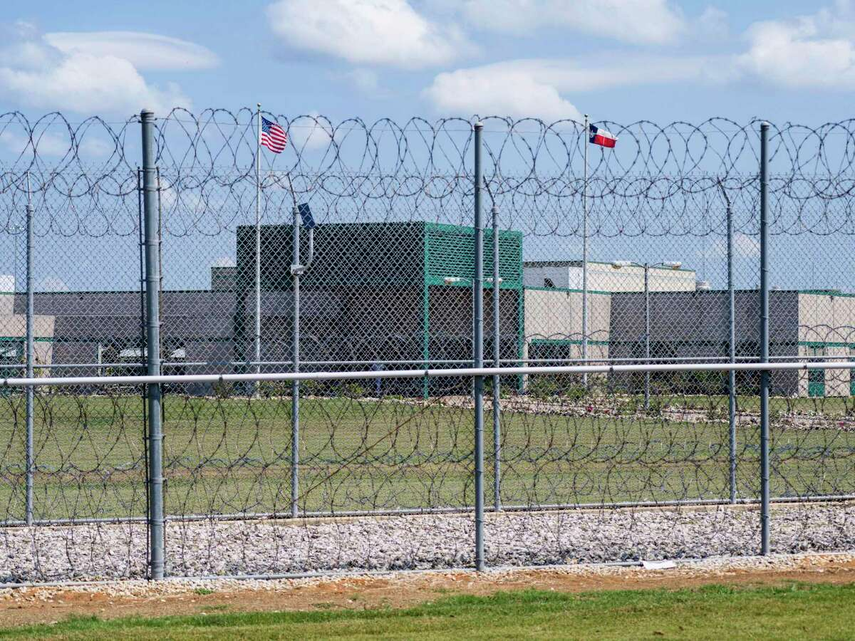 """Outside the Allan B. Polunsky Unit prison, where death row inmate John Henry Ramirez is incarcerated, in Livingston, Texas, Aug. 25, 2021. Ramirez's federal lawsuit claims that the state's refusal to allow his pastor to lay hands on him during his execution burdens his free exercise of religion at the exact moment """"when most Christians believe they will either ascend to heaven or descend to hell - in other words, when religious instruction and practice is most needed."""" (Matthew Busch/The New York Times)"""