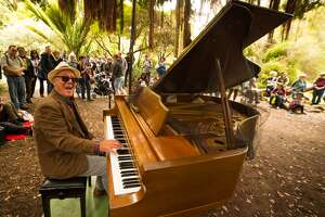 A community member plays a flower piano in 2019 in Golden Gate Park.