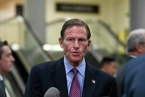 Sen. Richard Blumenthal, D-Conn., talks with reporters on Capitol Hill in Washington, Wednesday, July 10, 2019, before attending a briefing on election security.