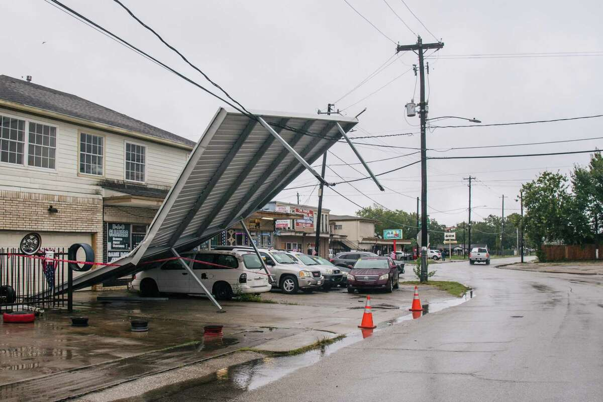 HOUSTON, TEXAS - SEPTEMBER 14: A carport hangs from power-lines after Tropical Storm Nicholas moved through the area on September 14, 2021 in Houston, Texas. Tropical Storm Nicholas strengthened to a Category 1 hurricane as it made landfall late Monday evening, but is gradually weakening as it moves towards the Northeast. Nicholas is projected to become a tropical depression by tomorrow. (Photo by Brandon Bell/Getty Images)