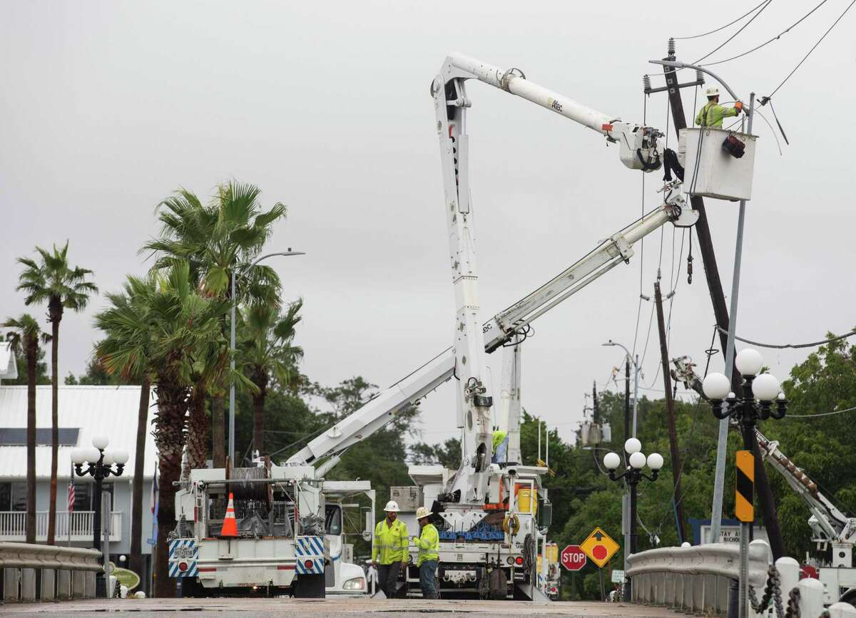 Workers repairing a downed power line on Clear Lake Road Tuesday, Sept. 14, 2021, in Clear Lake Shore.