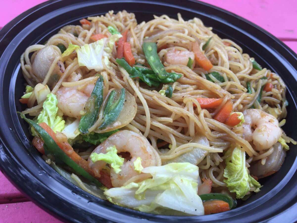 The pancit bowl with shrimp includes rice noodles, garlic, chopped carrot and green onions