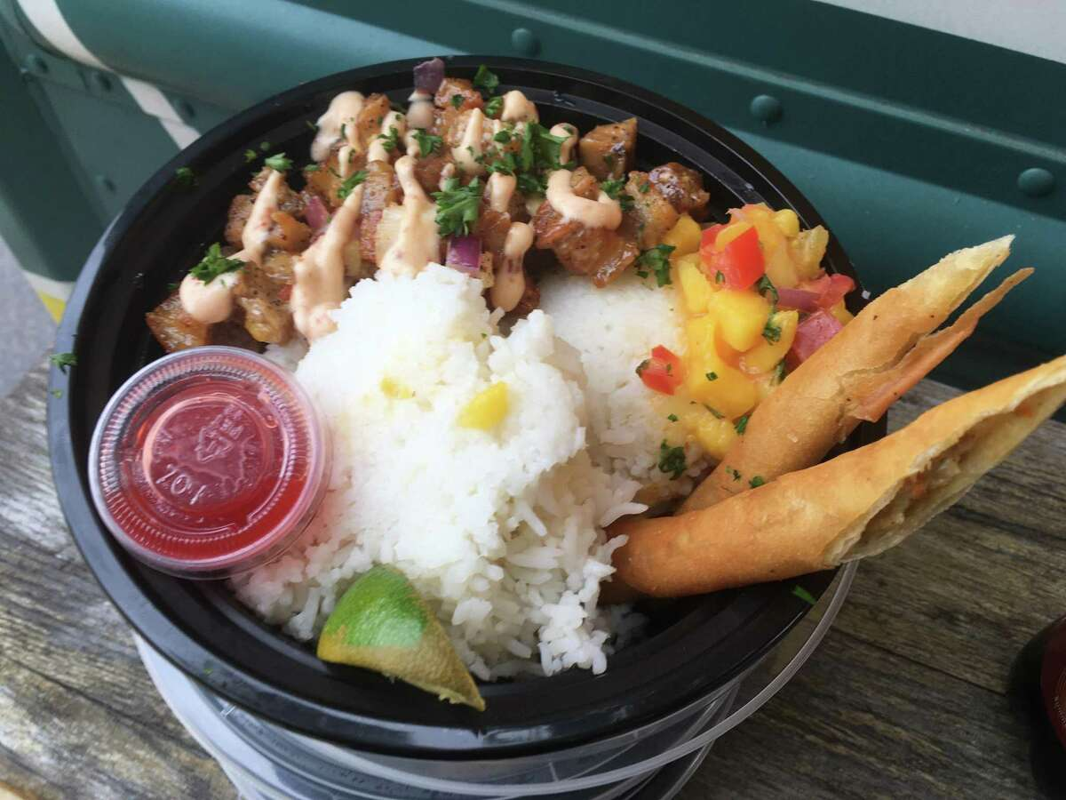 The sisig bowl includes two lumpia as well as pork belly with serrano peppers, onions lime juice and chipotle peppers.
