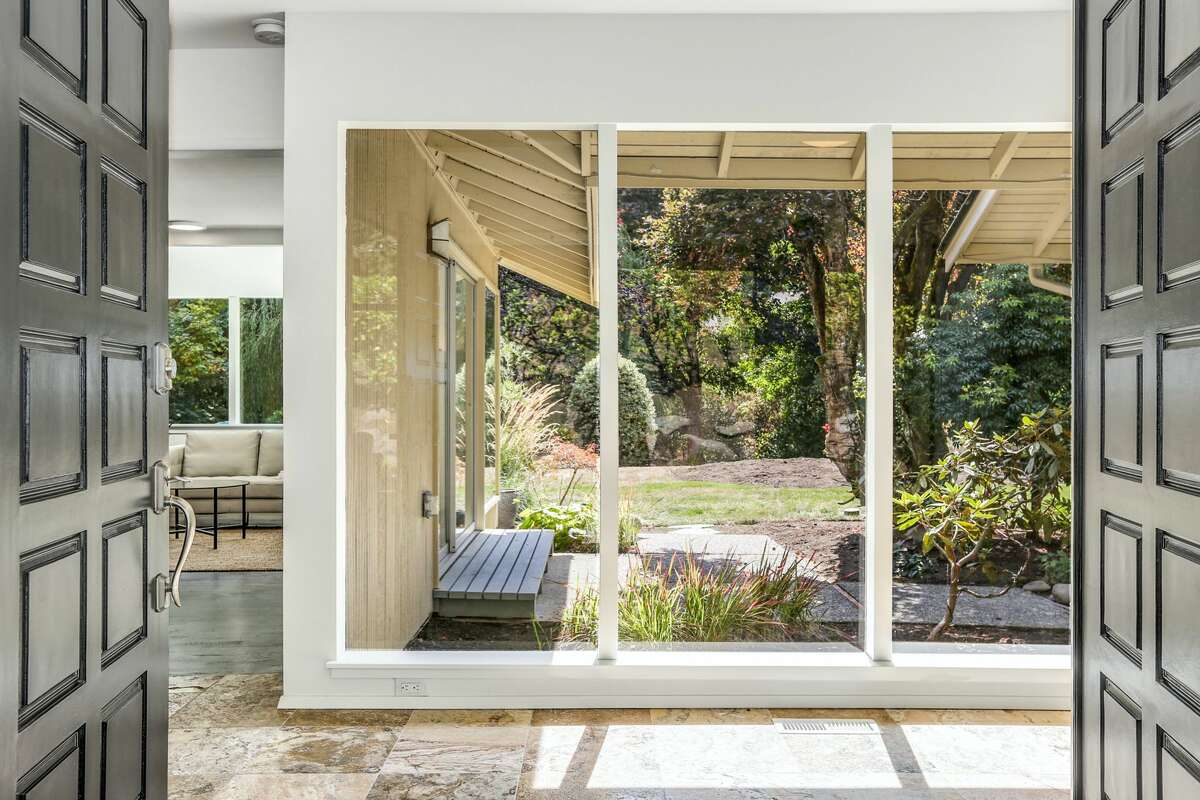 The entryway showcases classic midcentury modern blurring of interior and exterior elements.