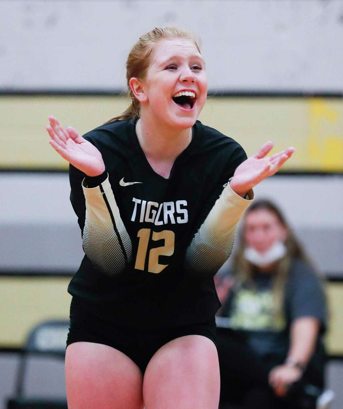 Conroe libero Emma Malak (12) cheers during the third set of a non-district high school volleyball match at Conroe High School, Wednesday, Sept. 15, 2021, in Conroe.