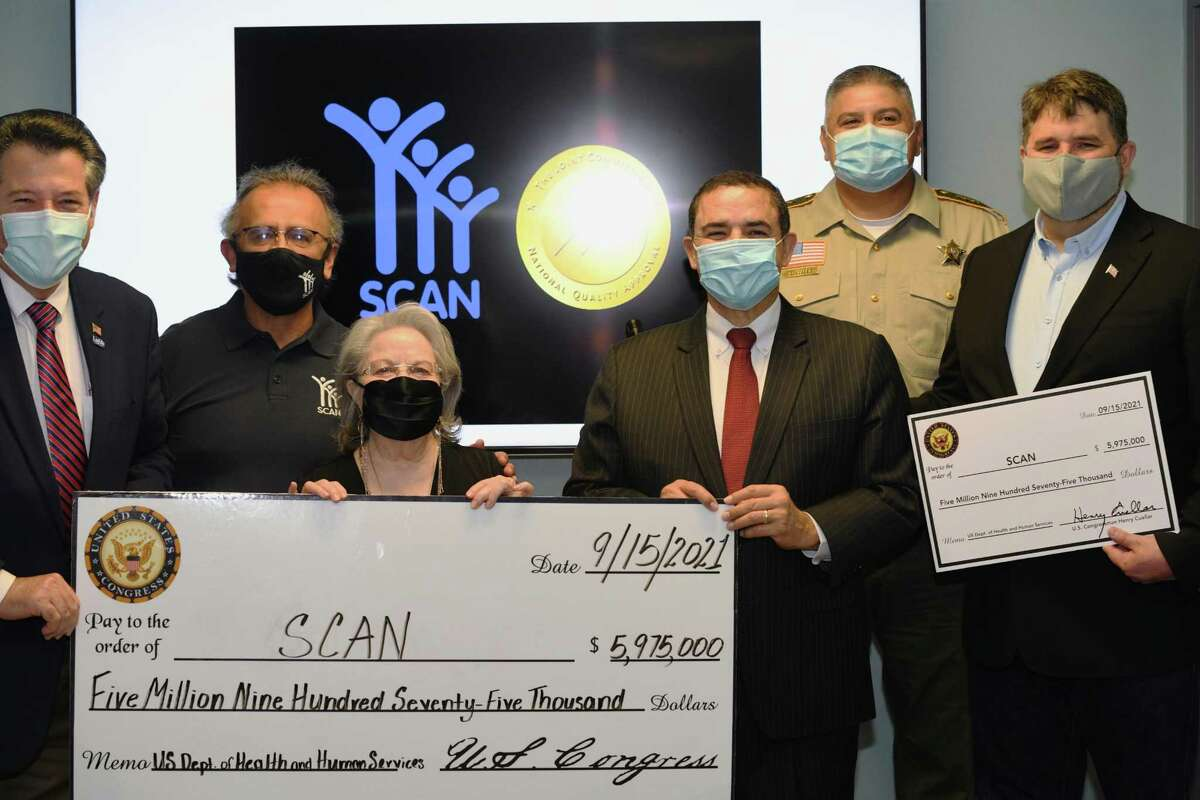 SCAN received a check of nearly $6 million after five grant applications were approved due to their performance these past two years. The check was presented by Congressman Henry Cuellar after SCAN leadership discussed the importance of their work.