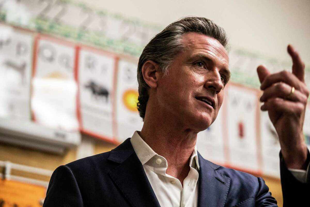 California Governor Gavin Newsom speaks to members of the media after meeting students at Melrose Leadership Academy during a school visit in Oakland, California Wednesday, Sept. 15, 2021.
