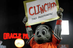 Lou Seal celebrates as the team clinches a playoff berth in a game between the San Diego Padres and San Francisco Giants on Sept. 13, 2021 at Oracle Park.