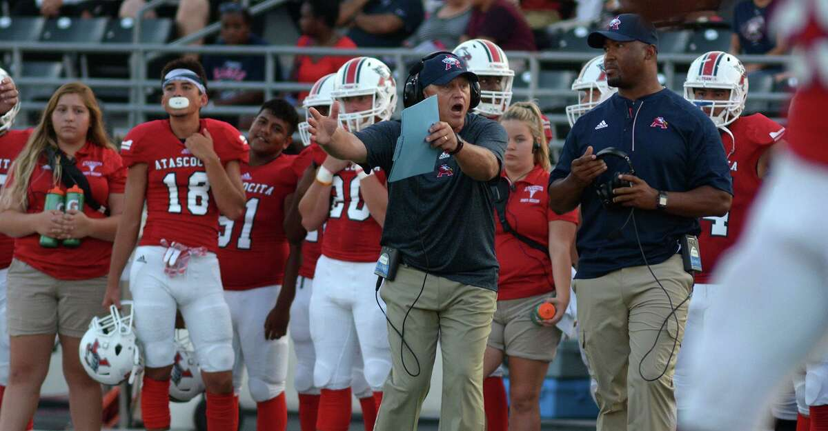 Atascocita head coach Craig Stump, center, works the sideline against Dekaney during their matchup at Turner Stadium on Sept. 1, 2016.