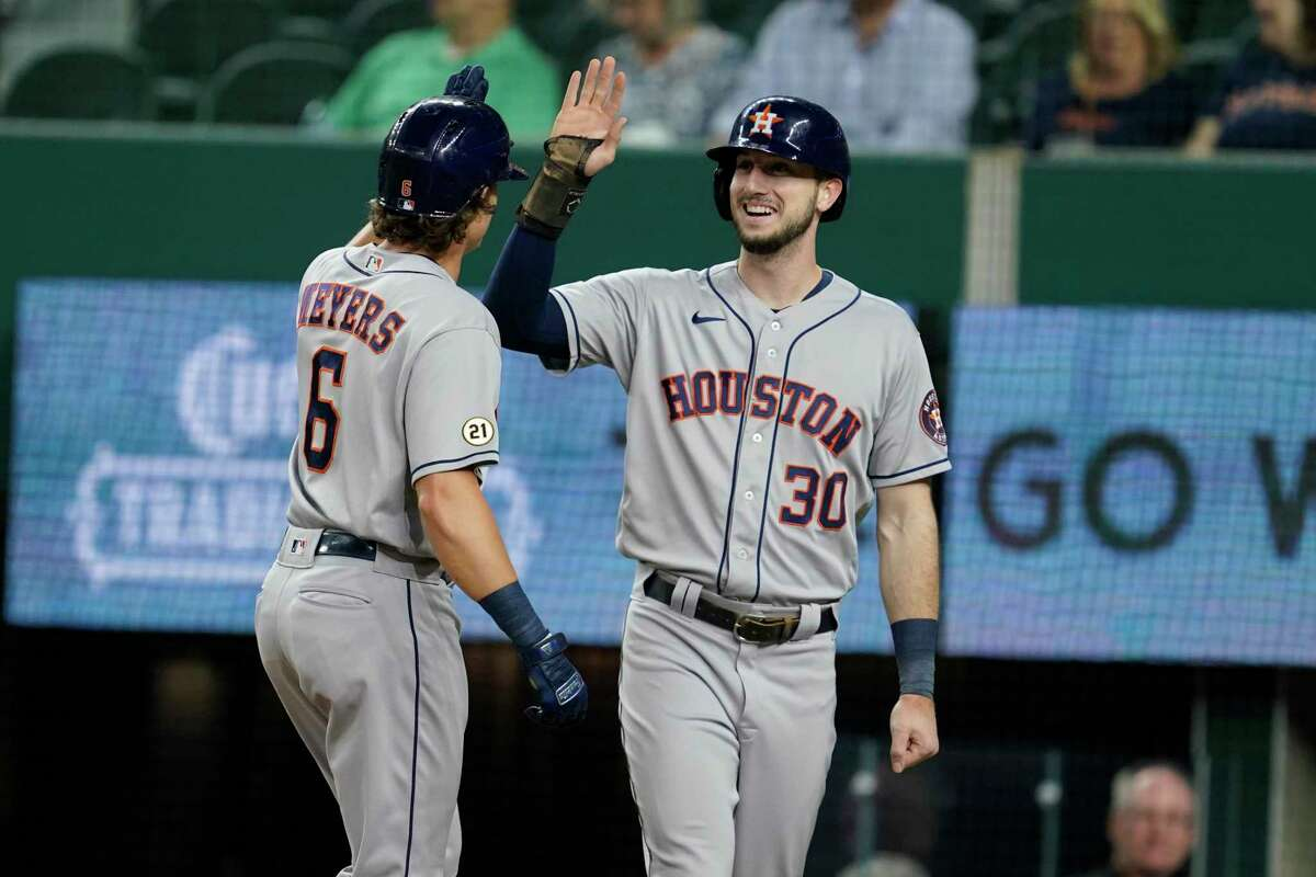 Houston Astros' Jake Meyers (6) and Kyle Tucker (30) celebrate a two-run home run hit by Meyers that scored Tucker in the second inning of a baseball game against the Texas Rangers in Arlington, Texas, Wednesday, Sept. 15, 2021. (AP Photo/Tony Gutierrez)