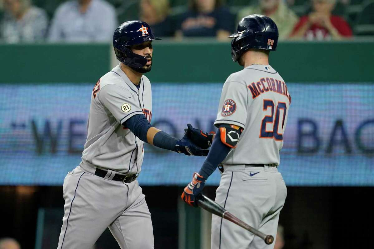 Marwin Gonzalez (left) celebrates his home run with teammate Chas McCormick during the Astros' victory over the Rangers on Wednesday night in Arlington.