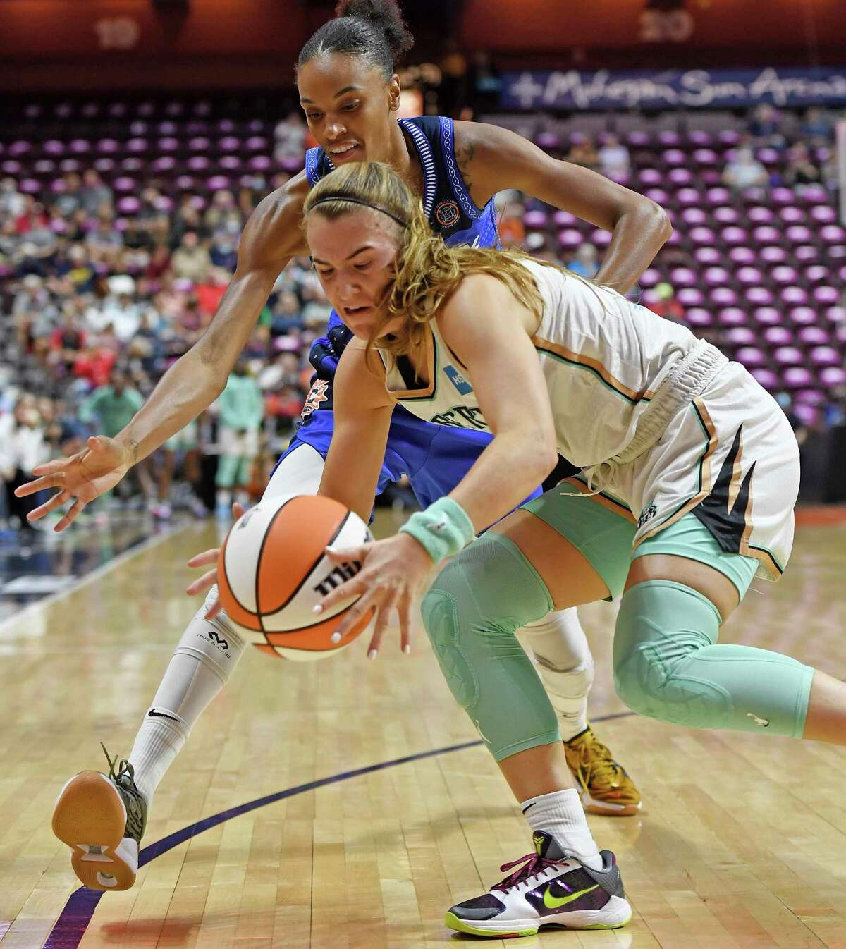 New York Liberty guard Sabrina Ionescu steals the ball from Connecticut Sun forward DwWanna Bonner during the first half of a WNBA basketball game Wednesday, Sept. 15, 2021, in Uncasville, Conn. (Sean D. Elliot/The Day via AP)