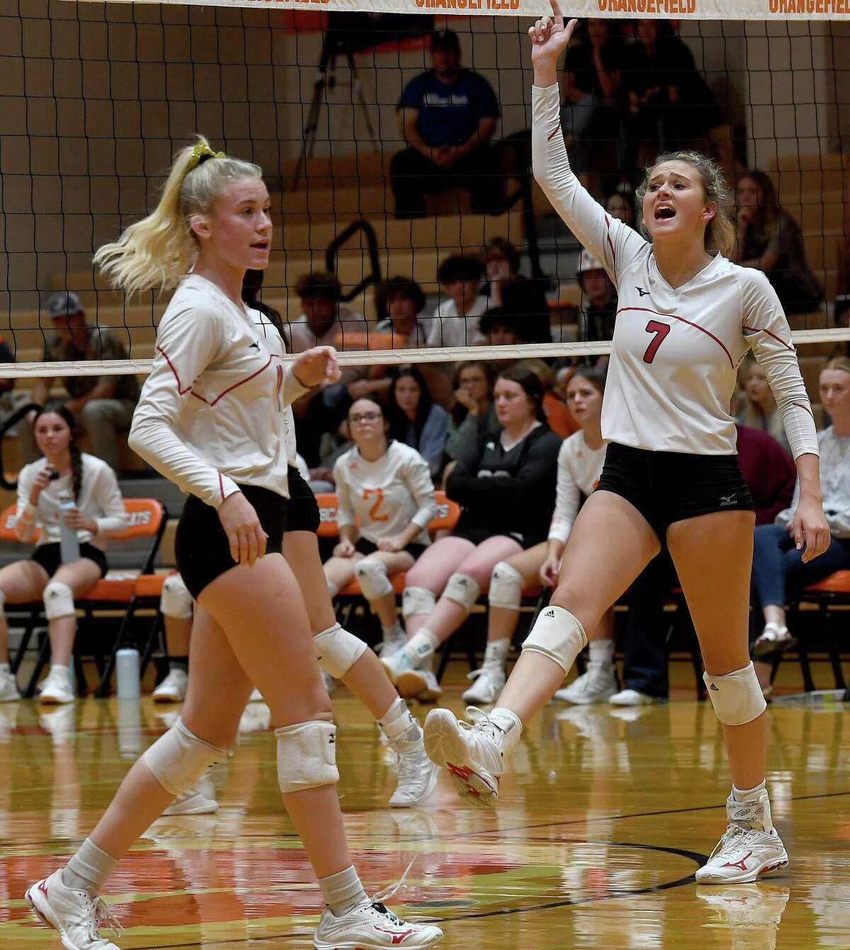 Bridge City's Taryn Dorion and teammates react after advancing against Orangefield during their volleyball match-up at Orangefield. Photo made Wednesday, September 15, 2021 Kim Brent/The Enterprise