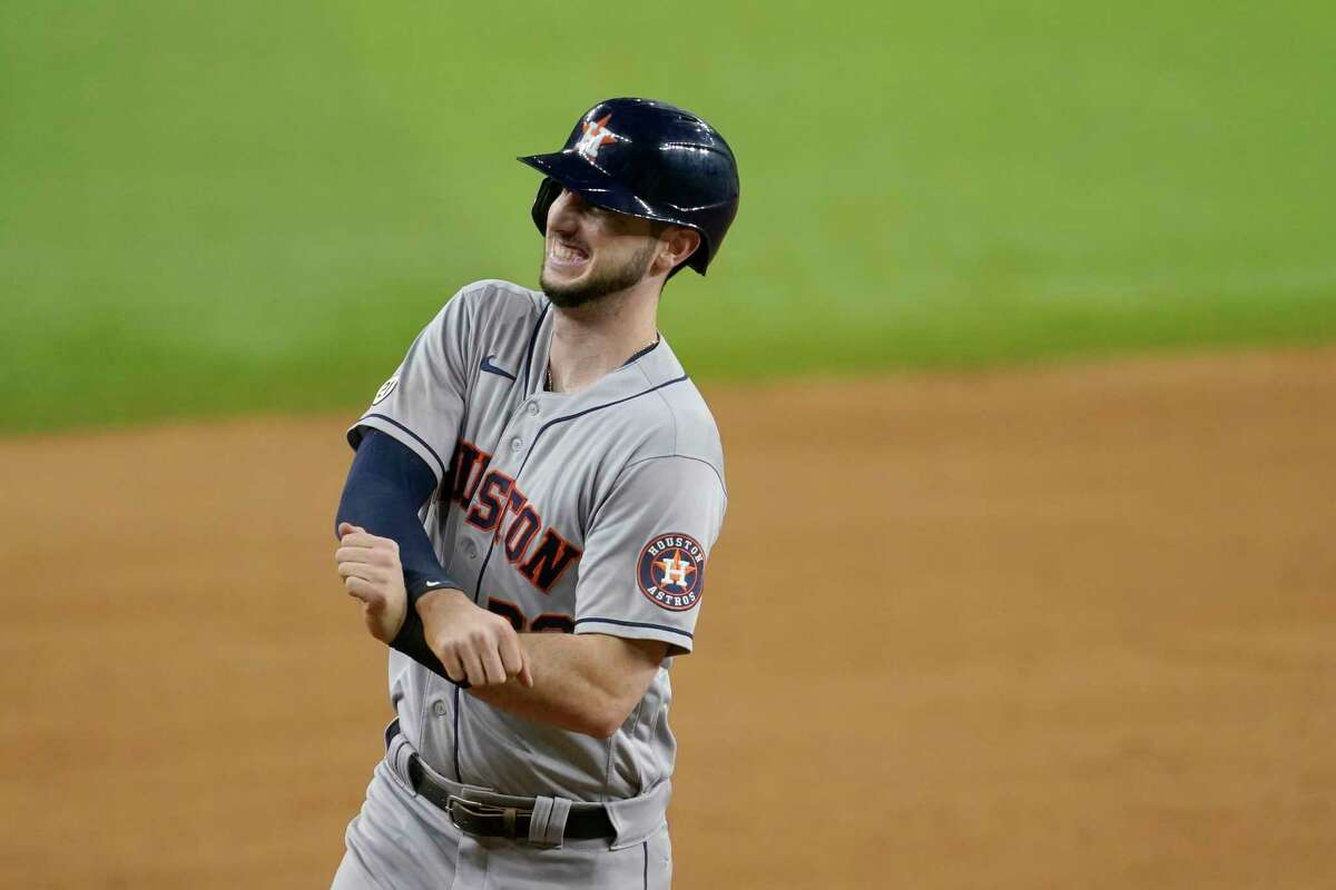Houston Astros' Kyle Tucker gestures to the team's dugout as he rounds the bases after hitting a solo home run in the eighth inning of a baseball game against the Texas Rangers in Arlington, Texas, Wednesday, Sept. 15, 2021. (AP Photo/Tony Gutierrez)