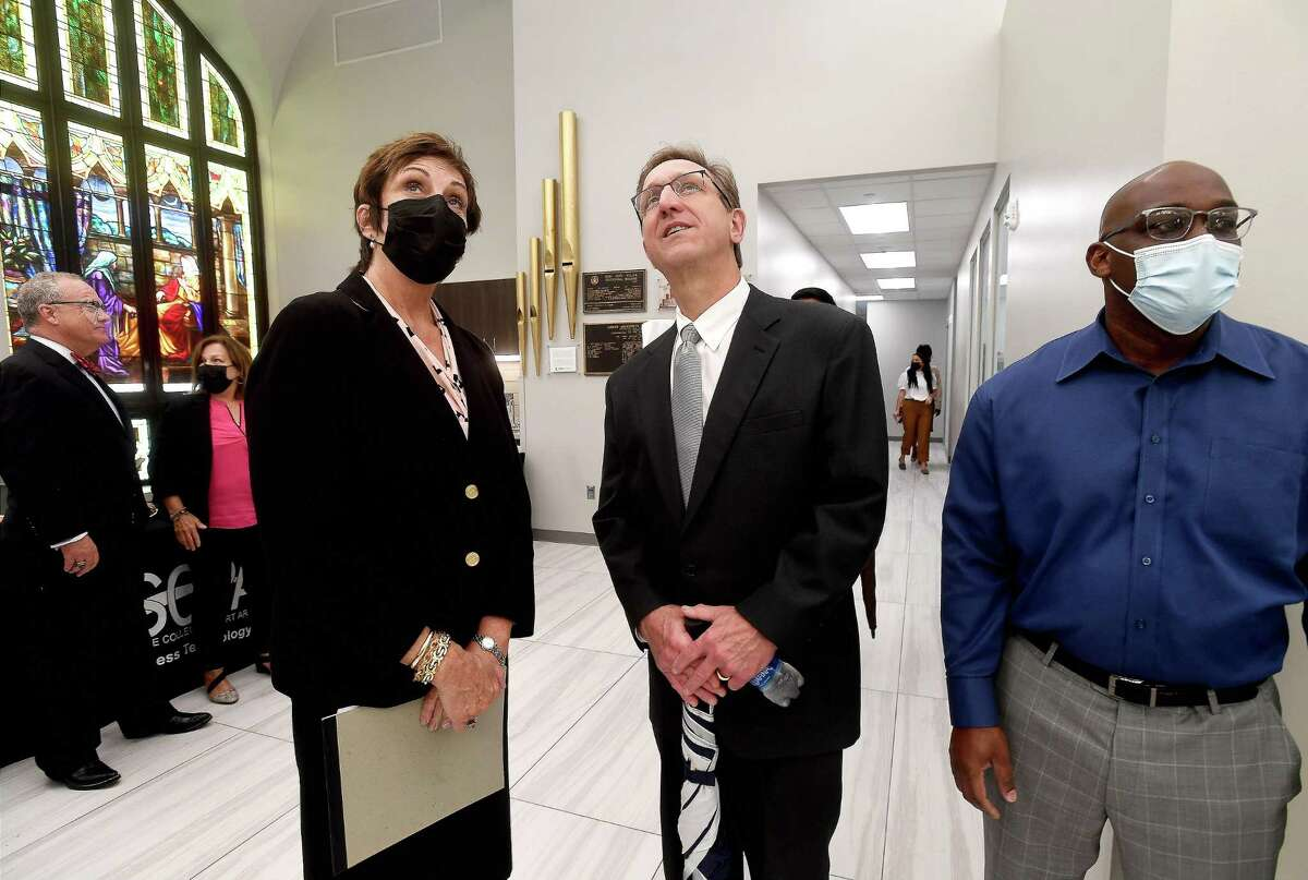 LSCPA President Betty Reynard talks with Jefferson County Judge Jeff Branick as he admires the preserved architecture and old church windows during the ribbon cutting and official celebration of the Ruby Fuller Building at Lamar State College Port Arthur Wednesday. The 106 year old building was originally First United Methodist Church before being sold to the college in 1976. The site is being used for classrooms and office space for various programs, including Title V. Photo made Wednesday, September 15, 2021 Kim Brent/The Enterprise