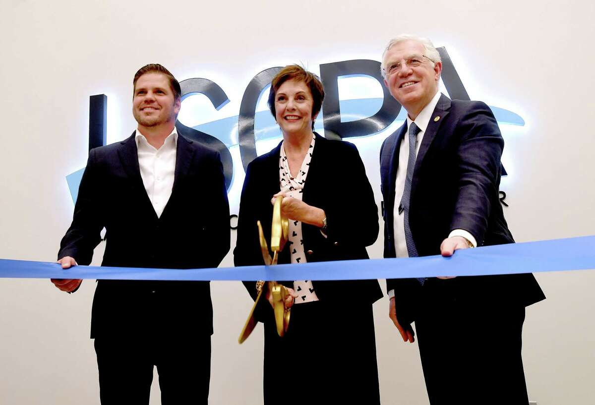 From left, Brian Brown with O'Donnnell Snider Construction, LSCPA President Betty Reynard and Sina Nejad with Sigma Engineers perform the official ribbon cutting during the celebration of the Ruby Fuller Building at Lamar State College Port Arthur Wednesday. The 106 year old building was originally First United Methodist Church before being sold to the college in 1976. The site is being used for classrooms and office space for various programs, including Title V. Photo made Wednesday, September 15, 2021 Kim Brent/The Enterprise