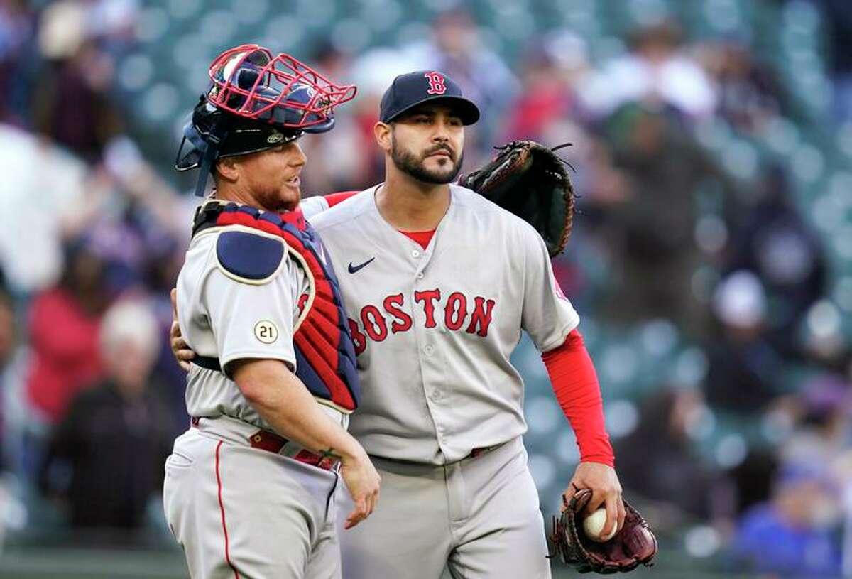 Catcher Christian Vazquez (left) and pitcher Martin Perez celebrate Boston's victory in Seattle.