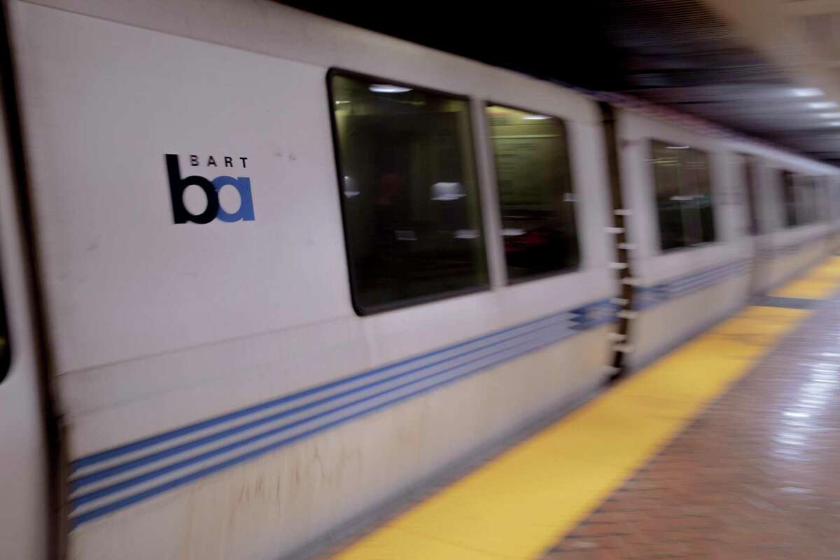 A BART train passes a station. A BART passenger was found dead late Tuesday on a train at a Pleasant Hill station, officials said.