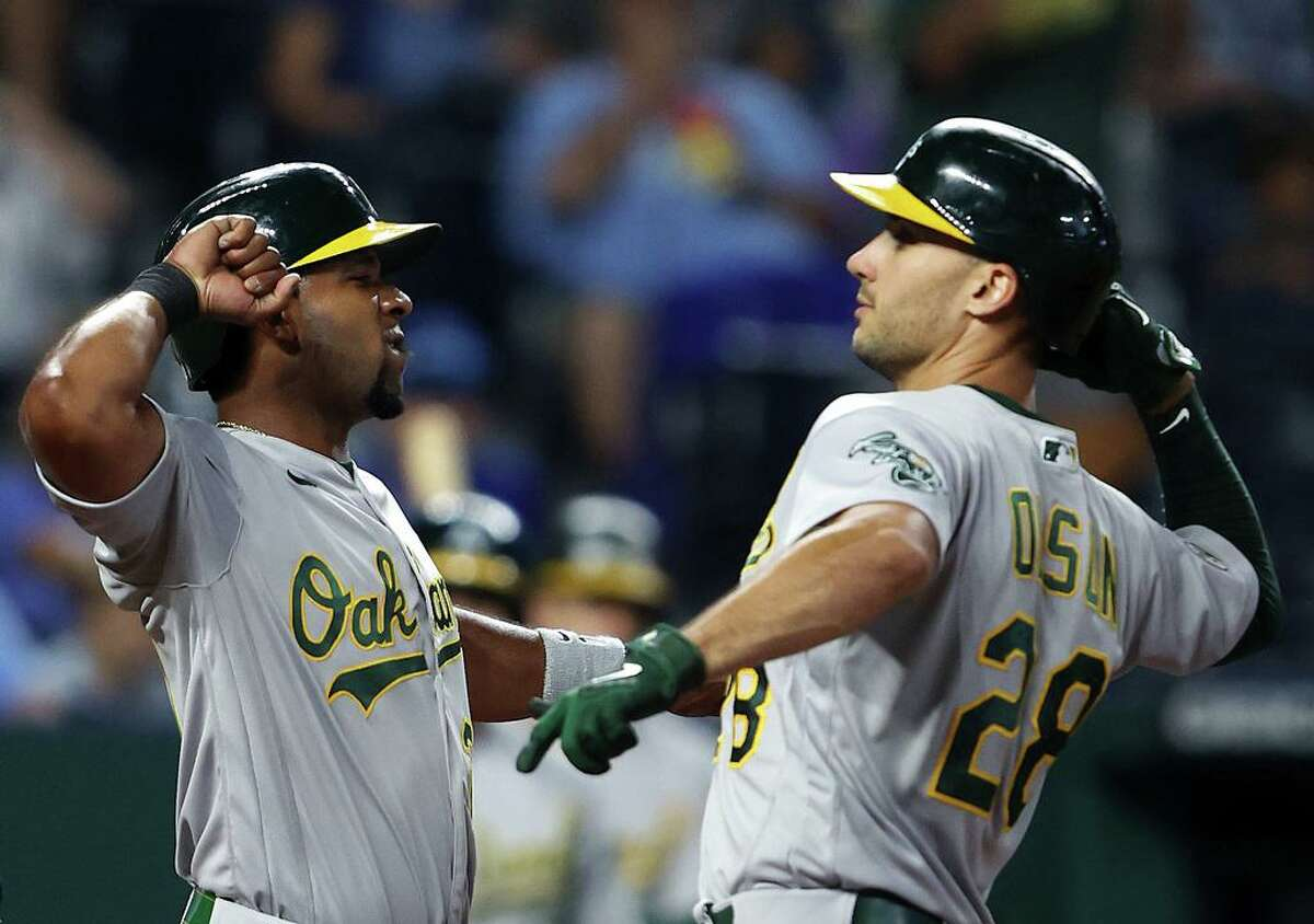 KANSAS CITY, MISSOURI - SEPTEMBER 15: Elvis Andrus #17 of the Oakland Athletics congratulates Matt Olson #28 after Olson hit a 2-run home run during the 4th inning of the game against the Kansas City Royals at Kauffman Stadium on September 15, 2021 in Kansas City, Missouri. (Photo by Jamie Squire/Getty Images)