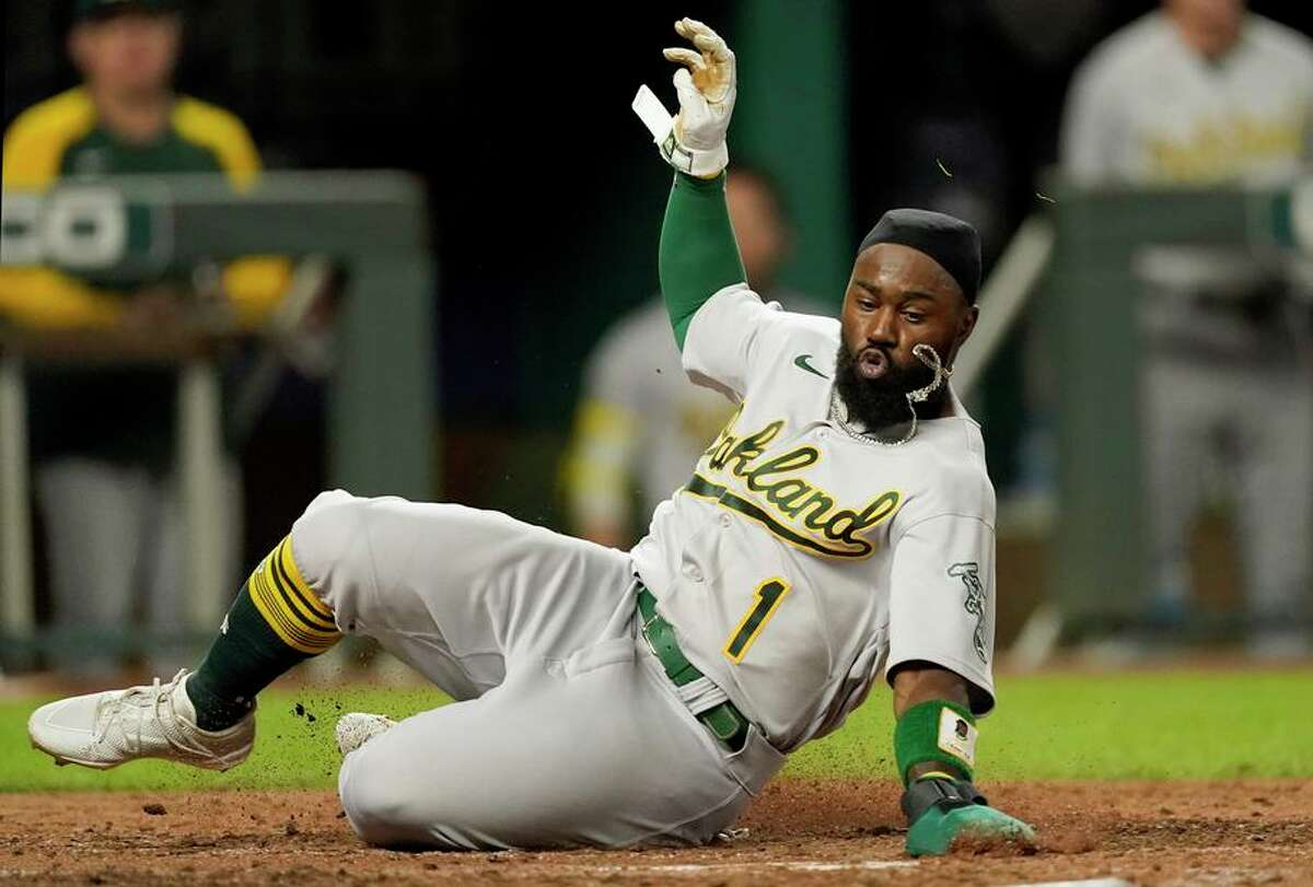 Josh Harrison slides home in the seventh inning, but his biggest play was to start a double play that ended the fourth.