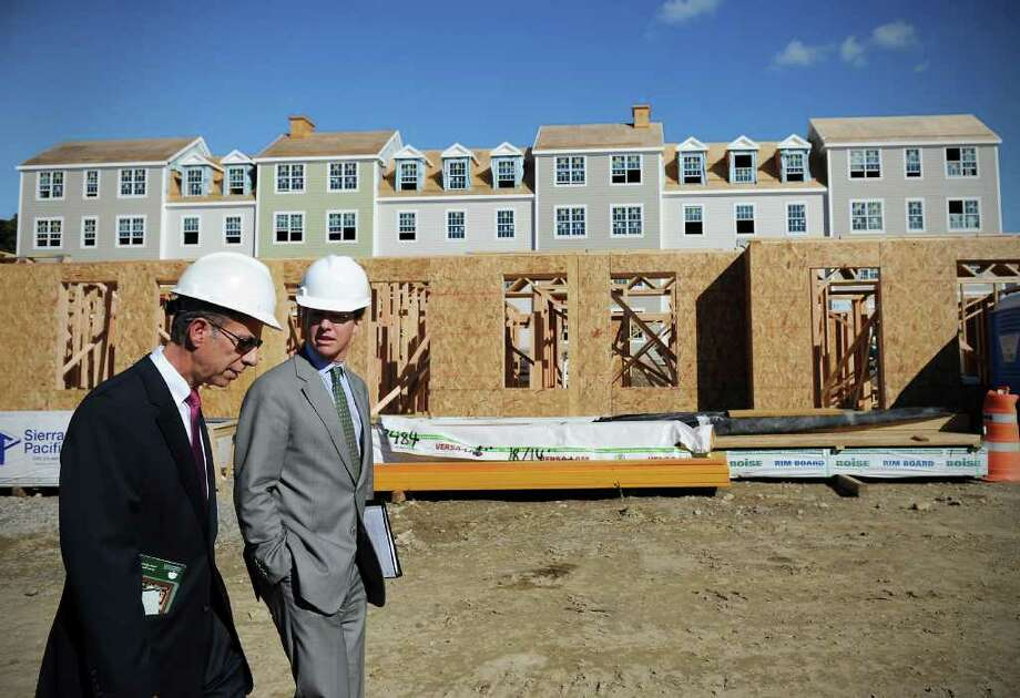 U.S. HUD Secretary Sean Donovan joins Vin Tufo, executive director of Charter Oak Communities, as they tour the new apartment development at 58 Progress Drive, which is part of  Vidal Court Revitalization Project, in Stamford, Conn. on Friday September 17,  2010. Photo: Kathleen O'Rourke / Stamford Advocate
