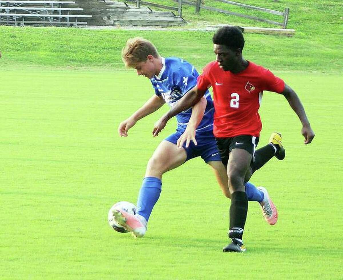 Alton's Noah Hardin (2) scored a first-half goal for Alton Wednesday night at Collinsville. The Redbirds trailed 2-1 at halftime, but fell to the Kahoks 4-1. Hardin is shown battling Marquette's Joe Brangenberg during a summer exhibition game against Marquette Catholic.