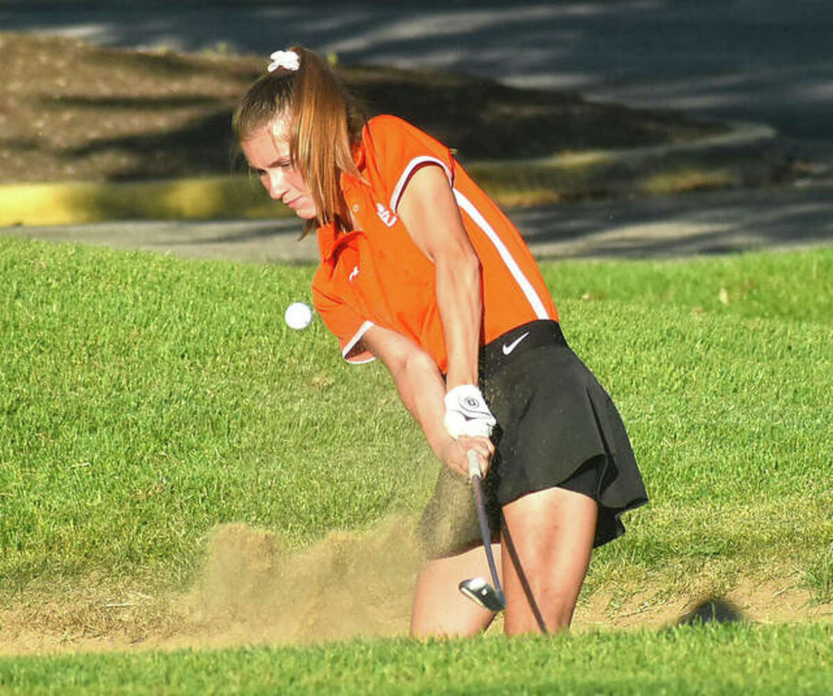 Edwardsville's Emilie Fry hits a bunker shot on No. 9 at Spencer T. Olin Golf Course during a triangular with Marquette and Triad on Wednesday in Alton.