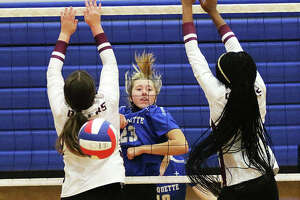 Marquette Catholic's Kylie Murray (middle) watches her attack between two EA-WR blockers fall for a kill in an Aug. 23 match at the Roxana Tourney. On Wednesday, Murray had a career-high 10 kills in the Explorers' win over Cahokia in Alton.