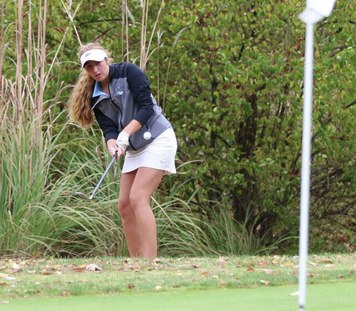Jersey's Bria Tuttle, shown chipping toward the pin during last season's Class 1A sectional at Salem, shot 43 on Wednesday at Belk Park in Wood River to lead the Panthers to dual victories over Roxana and Dupo.