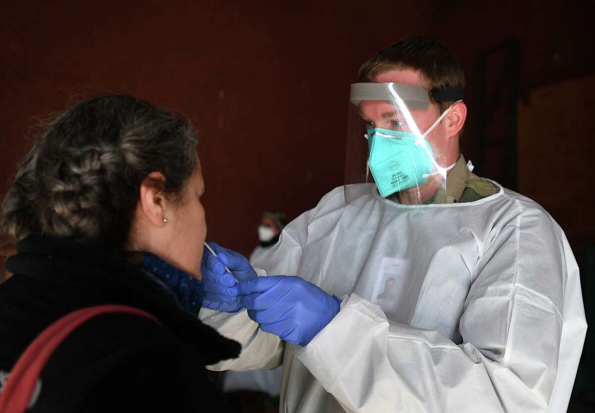 Connecticut National Guard Sergeant Collin Paternoster administers free Covid-19 tests at the new Fair Haven Community Health Center testing site at 293 East Street in New Haven, Conn. on Thursday, December 3, 2020.