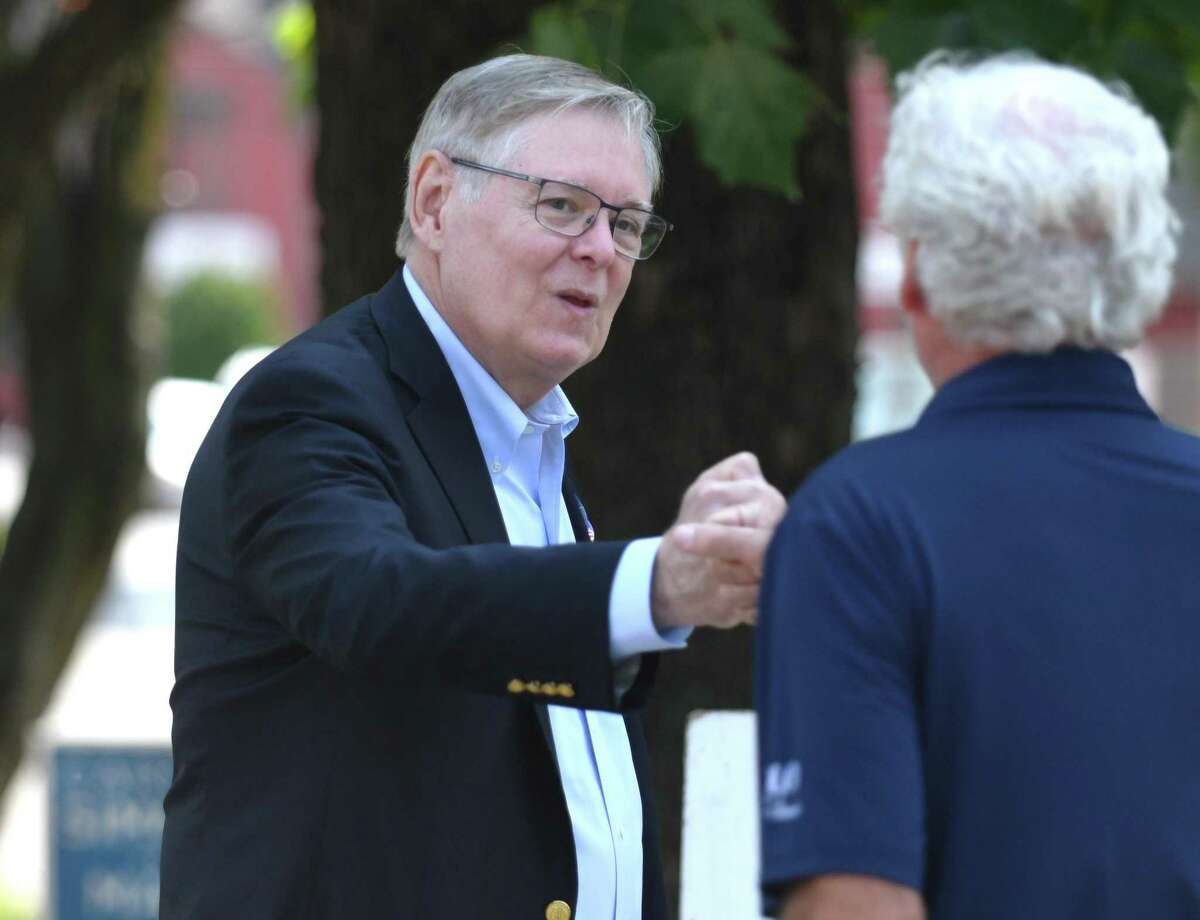 Stamford incumbent Mayor David Martin chats with a voter outside Dolan Middle School on Primary Election Day in Stamford, Conn. Tuesday, Sept. 14, 2021.