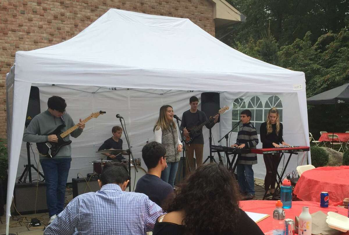 The St. Francis of Assisi Parish Family Fun Carnival at 35 Norfield Road in Weston, is taking place on the event's eleventh anniversary, from noon to 6 p.m., Oct. 2, and Oct. 3, rain, or shine. Live music, including from the members of the band, the Fairfield School of Rock, is shown.