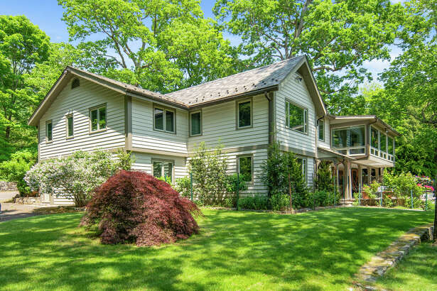 The main home on 1021 Rock Rimmon Road in Stamford, Conn. has five bedrooms and large windows overlooking the property.