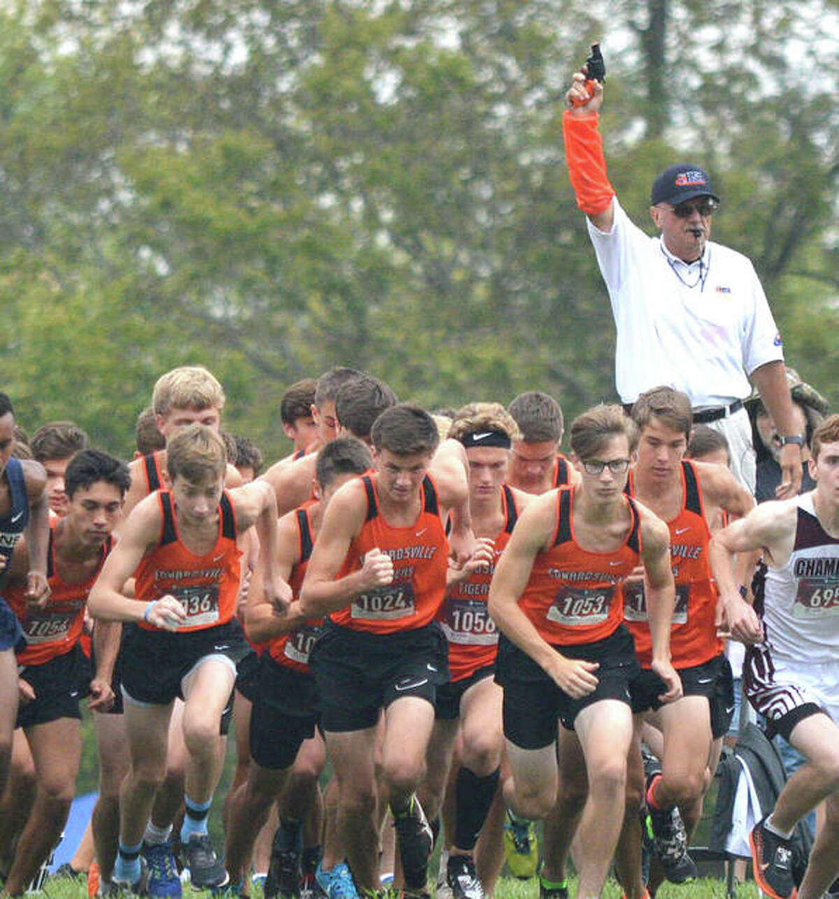 The Edwardsville boys cross country team gets off to a fast start at the Edwardsville Invitational at the SIUE course in 2019.