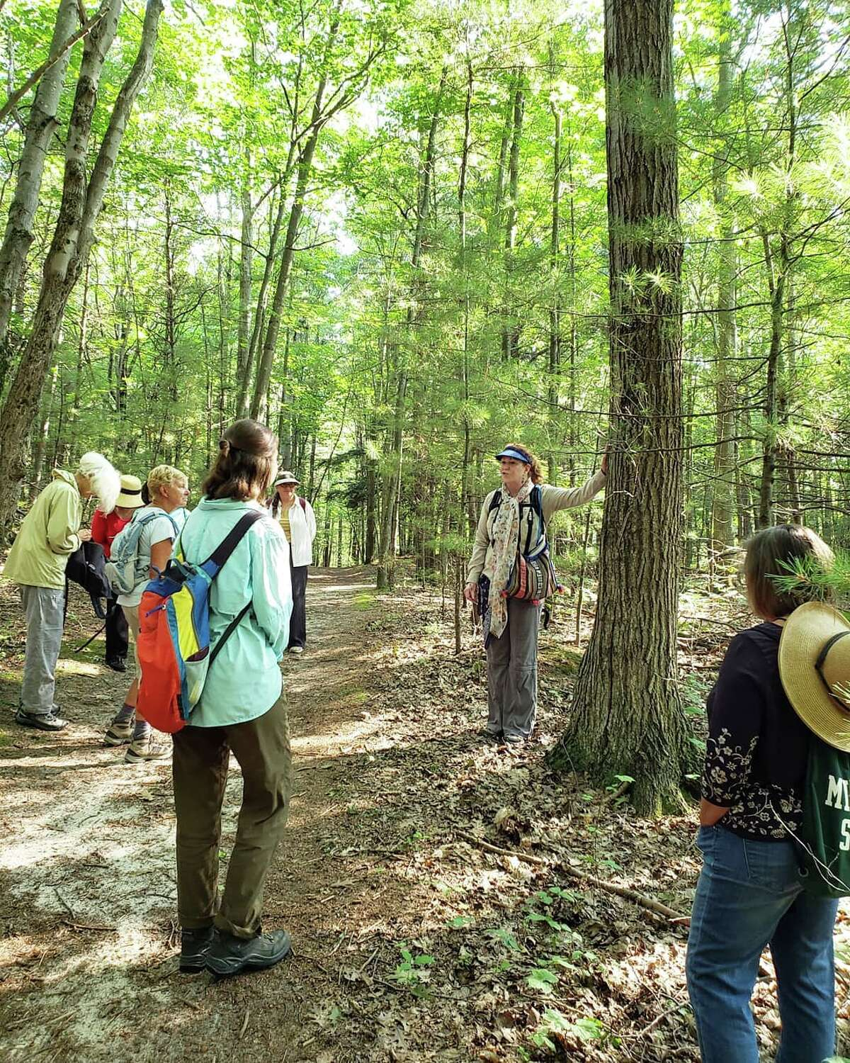 Gloria Garrett, of Mindfulness in Nature, is shown in the center of this photo leading a forest bathing workshop at Old Indian Trail off of M-22 in Benzie County.