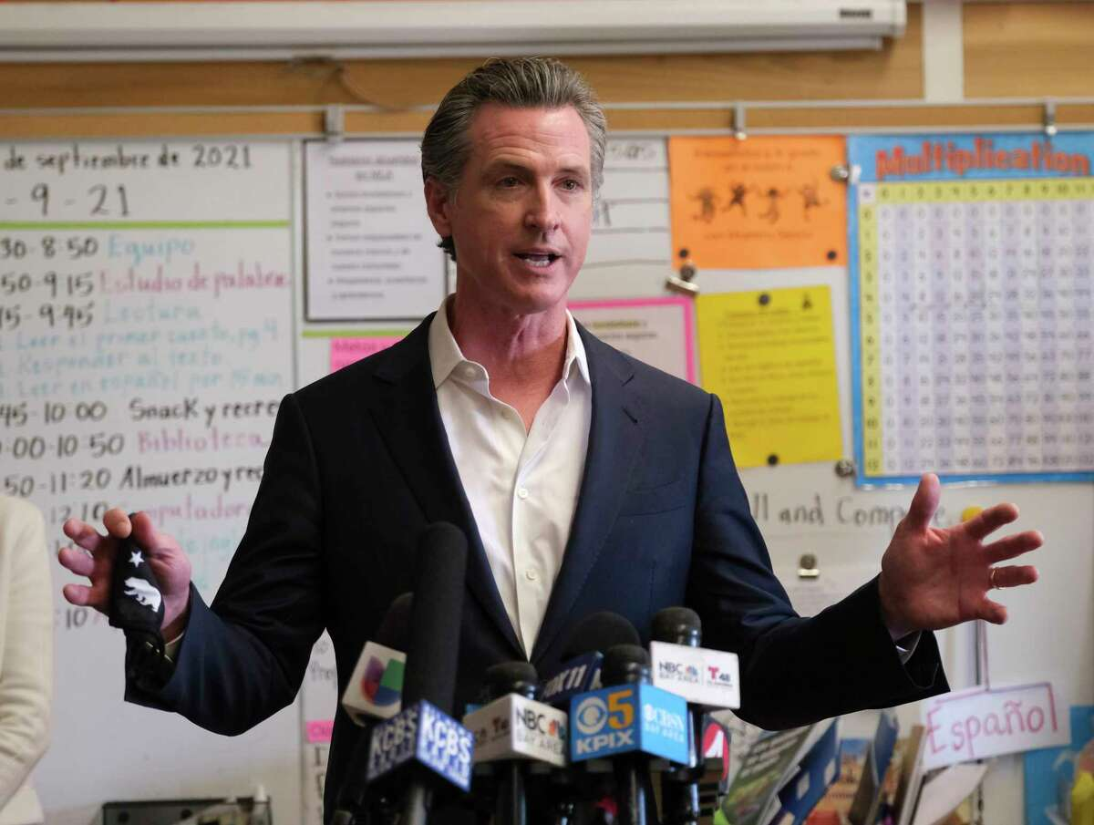 Gov. Gavin Newsom speaks to the press after visiting with students at Melrose Leadership Academy, a TK-8 school in Oakland, Calif., on Wednesday, Sept. 15, 2021.