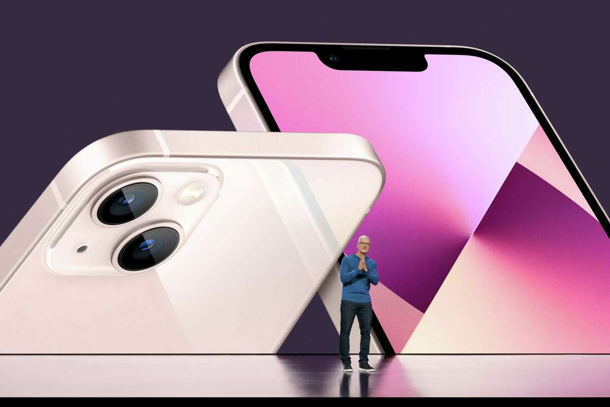 Apple CEO Tim Cook unveils the new iPhone 13 during an event at Apple Park on Sept. 14 in Cupertino, Calif.