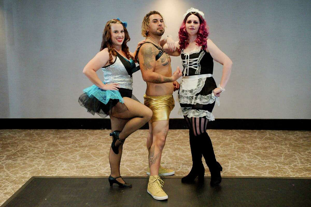 """Nate Perez, center, has lost almost 20 pounds and has worked out daily in preparation for his role as Rocky in Clear Creek Community Theatre's production of Richard O'Brien's """"The Rocky Horror Show."""" With him are cast members Stephanie Hendrickson and Eryn Dorsey,"""