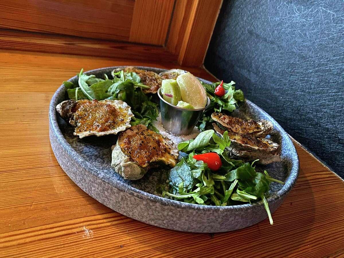 Oysters Oaxaca-feller incorporate chorizo-mezcal butter and a Parmesan crust at Frida Mexican Restaurant & Bar in Stone Oak.