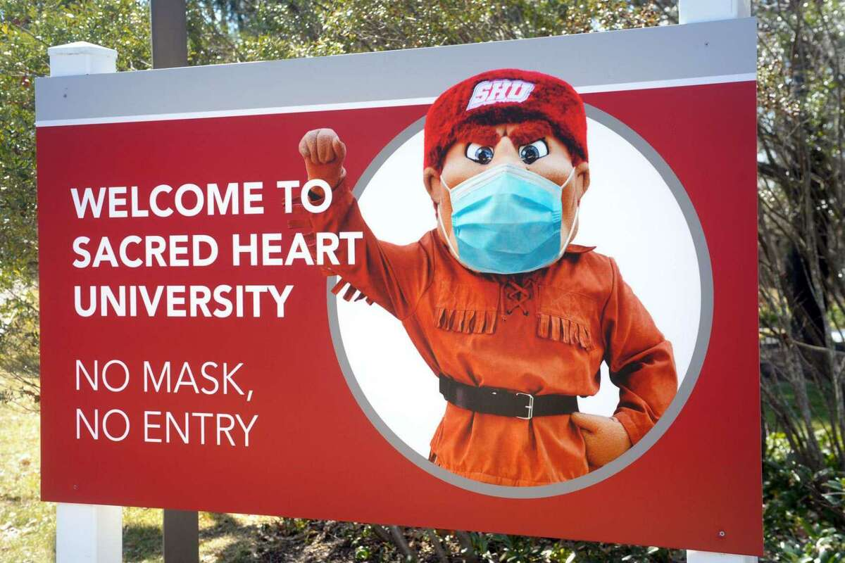 A sign at the entrance to Sacred Heart University's west campus, in Fairfield, Conn. March 10, 2021