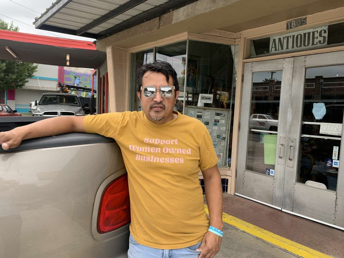 Roberto Soto Jr. of San Antonio Furniture Finders poses with his trusty truck, Goldie.