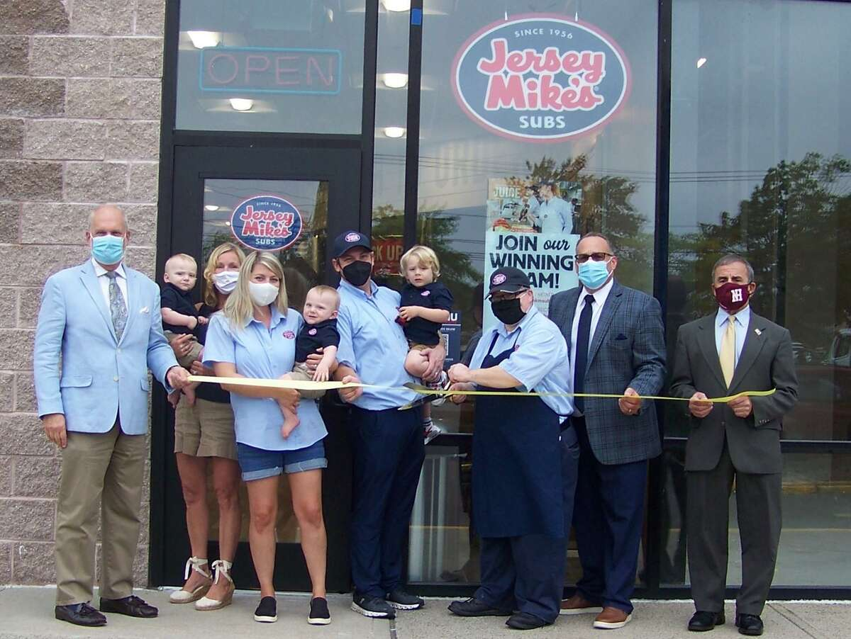 From left, Quinnipiac Chamber of Commerce Executive Director Ray Andrewsen; Diane Dauer; Kayla Thomson; owner Mitchell Thomson; store manager Brett Brayman; Gary Ciarleglio, Chamber regional director, Sales & Relationship Management; and North Haven First Selectman Mike Freda attend the ribbon-cutting for Jersey Mike's Subs, 410 Universal Drive in North Haven, Sept. 15. The eatery also does catering; visit www.jerseymikes.com/19030/north-haven-ct or call 203-672-4000.