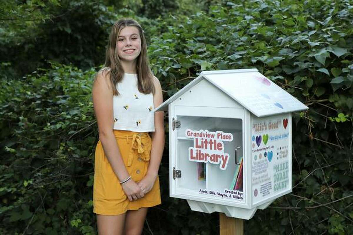 Annie Bozarth, a freshman at Edwardsville High, poses with the Little Library she and her stepfather, Wayne Downing, mother, Allison, and sister, Elle, built. The idea to build the Grandview Place Little Library, which stands just inside the entrance to the Grandview subdivision in Edwardsville, came about during the shutdowns from the pandemic. Their goal was to make people happy during a less than ideal time. With the approval of the HOA, they spent most of the past year building the house. The library is decorated with inspirational quotes with help from Eberhart Signs, which made and donated the decals.