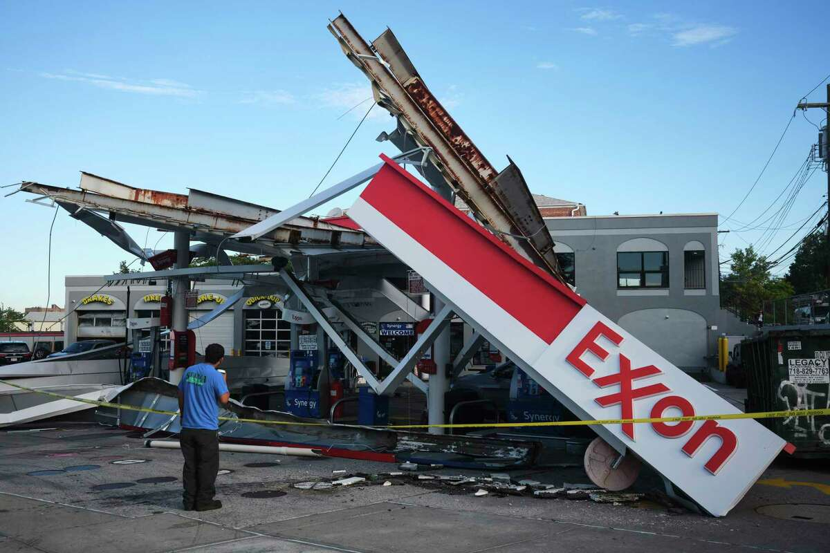 Damage to a New York gas station on Sept. 2, 2021, after Hurricane Ida. The House Oversight Committee has widened its probe into the oil and gas industry's role in spreading disinformation about the role of fossil fuels in causing global warming, calling on top executives from Exxon Mobil, Chevron, BP and Royal Dutch Shell, as well as the lobby groups American Petroleum Institute and the United States Chamber of Commerce, to testify before Congress.