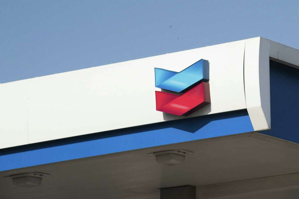 The Chevron logo is displayed at a gas station in Dallas. Chevron on Monday said it aspires to become a net-zero company by 2050, the latest oil major to set emissions goals to fight climate change.